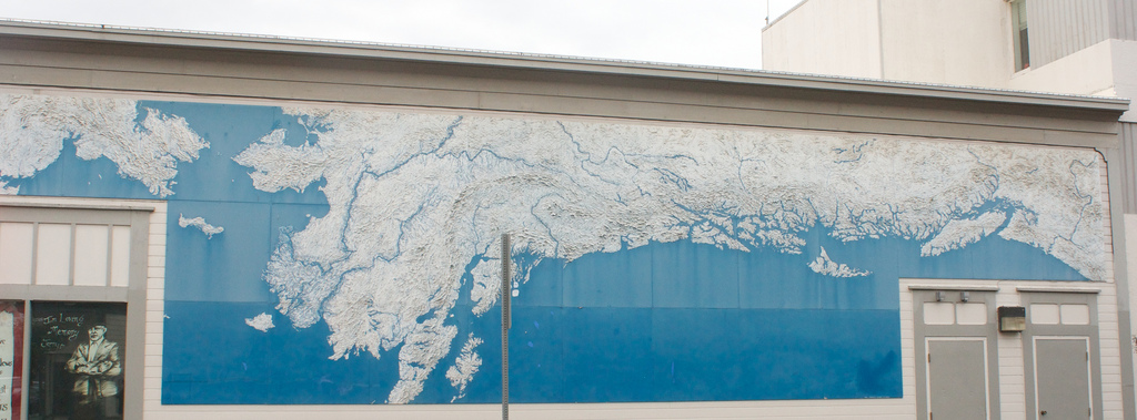 A very large map of the Pacific Northwest coast on the side of a building